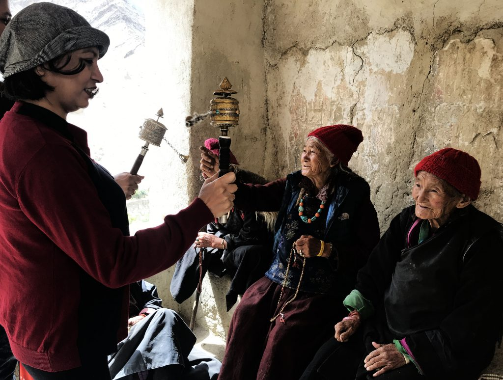 Learning to use prayer wheel